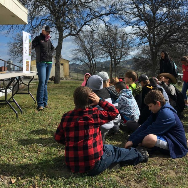 Ritta Martin, Glenn County RCD Program Coordinator, teaching 4th graders about the importance of worms at the Pathways to Nature Field trip in March 2018.