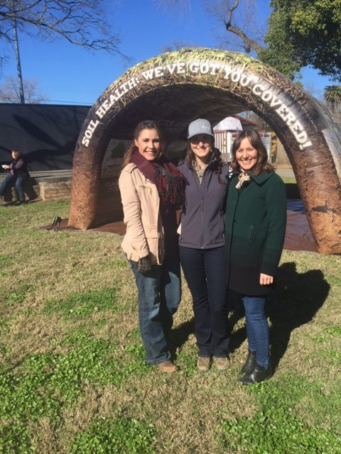 Staff pose with the inflatable soil health tunnel, which made its debut at the Colusa County farm show