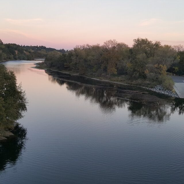 river in sunset with paved ramp